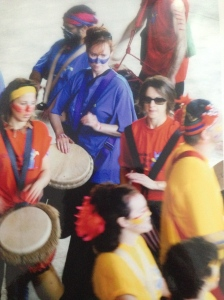 Me, in the middle in blue, participating in a public drumming performance, roughly ten years ago.