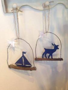 Week 1: Christmas ornaments made from recycled wood and wire from our farm